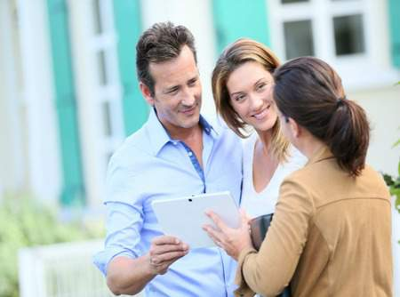 couple selling a home with real estate agent